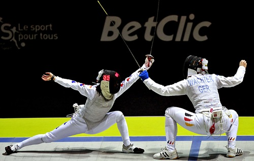 Nam Hyun Hee (L) of South Korea and Katja Wachter of Germany compete during the bronze medal final in the team foil competition at the 2010 World Fencing Championships at the Grand Palais in Paris, November 10, 2010. REUTERS/Jacky Naegelen  (FRANCE - Tags: SPORT FENCING)